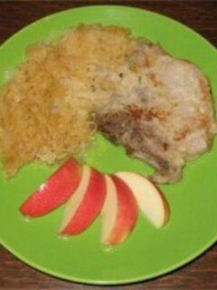 Porkchop with sauerkraut on green plate