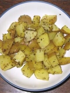 Oven-Roasted Potatoes with Herbs on white plate