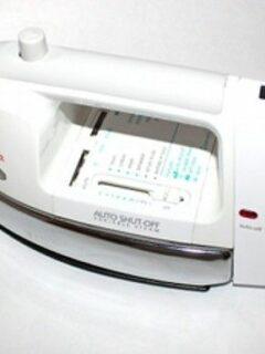 Clothing iron on white surface