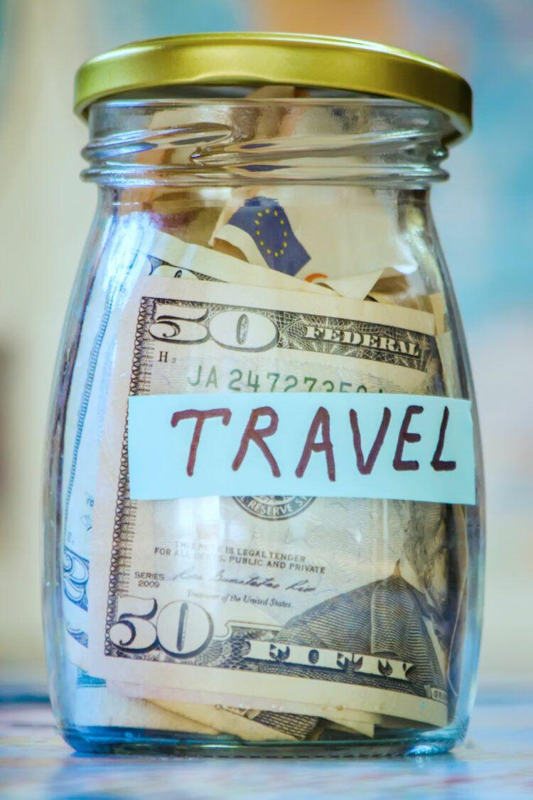Jar of money labeled travel