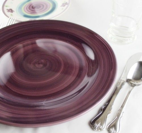 Purple plate with silverware