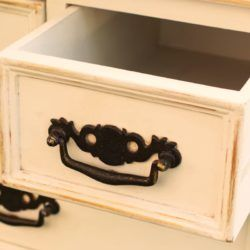 Modern drawers are sometimes designed so you can't remove them. That makes it hard to fish out something stuck behind a drawer. But there's a way! Read on the learn how. #snappyliving #stuckdrawer #diy #furniturehacks