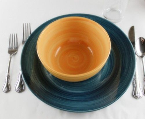 Plate with bowls and silverware on table