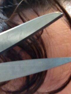 Scissors next to bangs