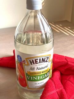 Bottle of vinegar with cleaning cloth