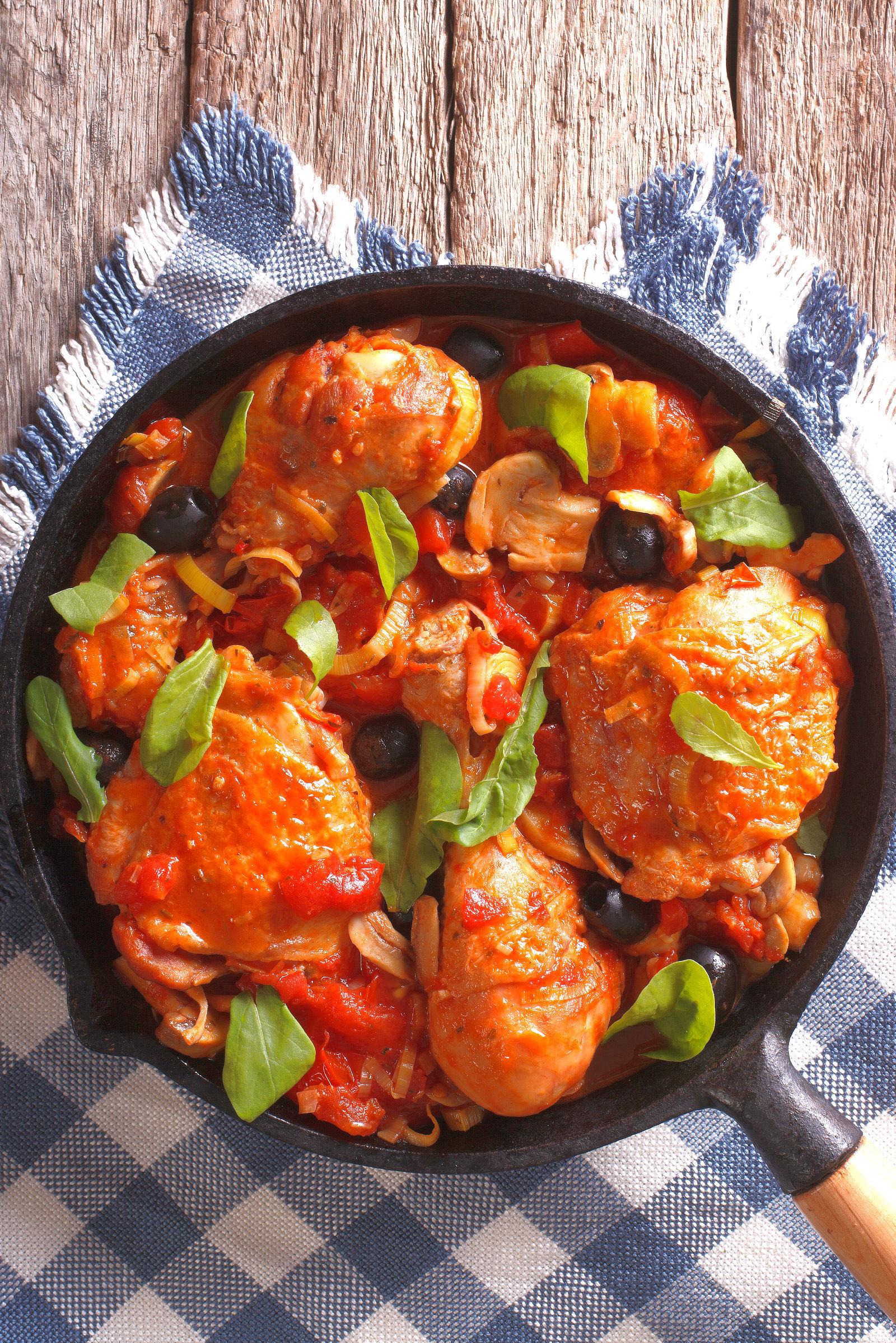 Bulk cooking chicken dish in skillet