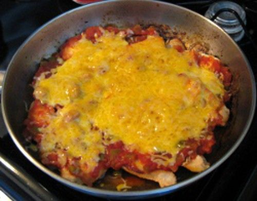 Cheesy Salsa Chicken cooking in pan