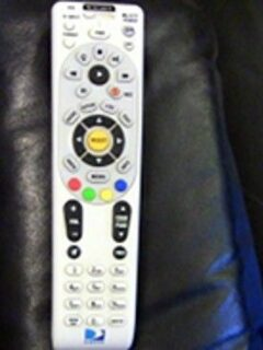 DirecTV remote on arm of chair