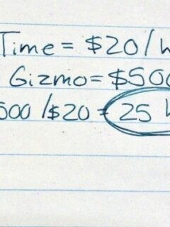 Handwritten calculation of new purchase in labor hours