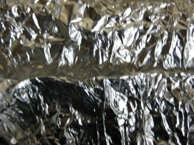 Closeup view of folds in tinfoil