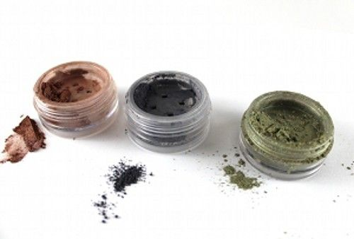 Three loose eyeshadows in their containers