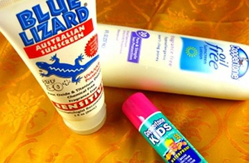 Assorted tubes and bottles of sunscreen