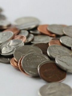 Pile of coins on white surface