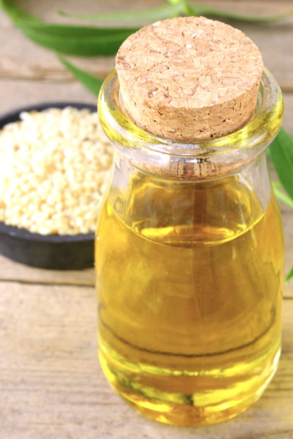 Bottle of sesame oil on table