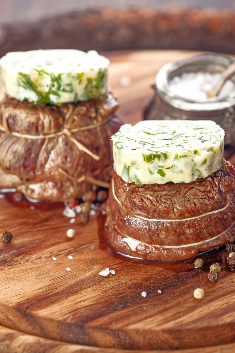 Steaks with herb compound butter pats
