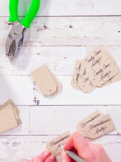Hands making homemade gift tags