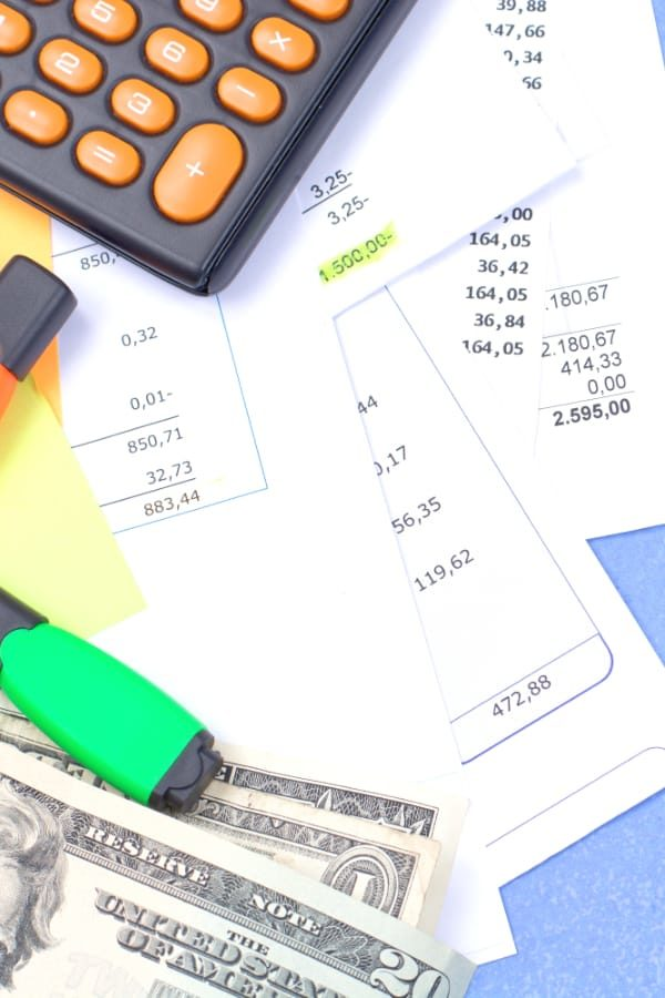 Receipts and bills with calculator and pen