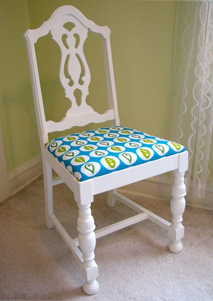White painted dining room chair with turquoise patterned upholstered seat
