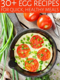 Eggs with tomato and herbs in a skillet