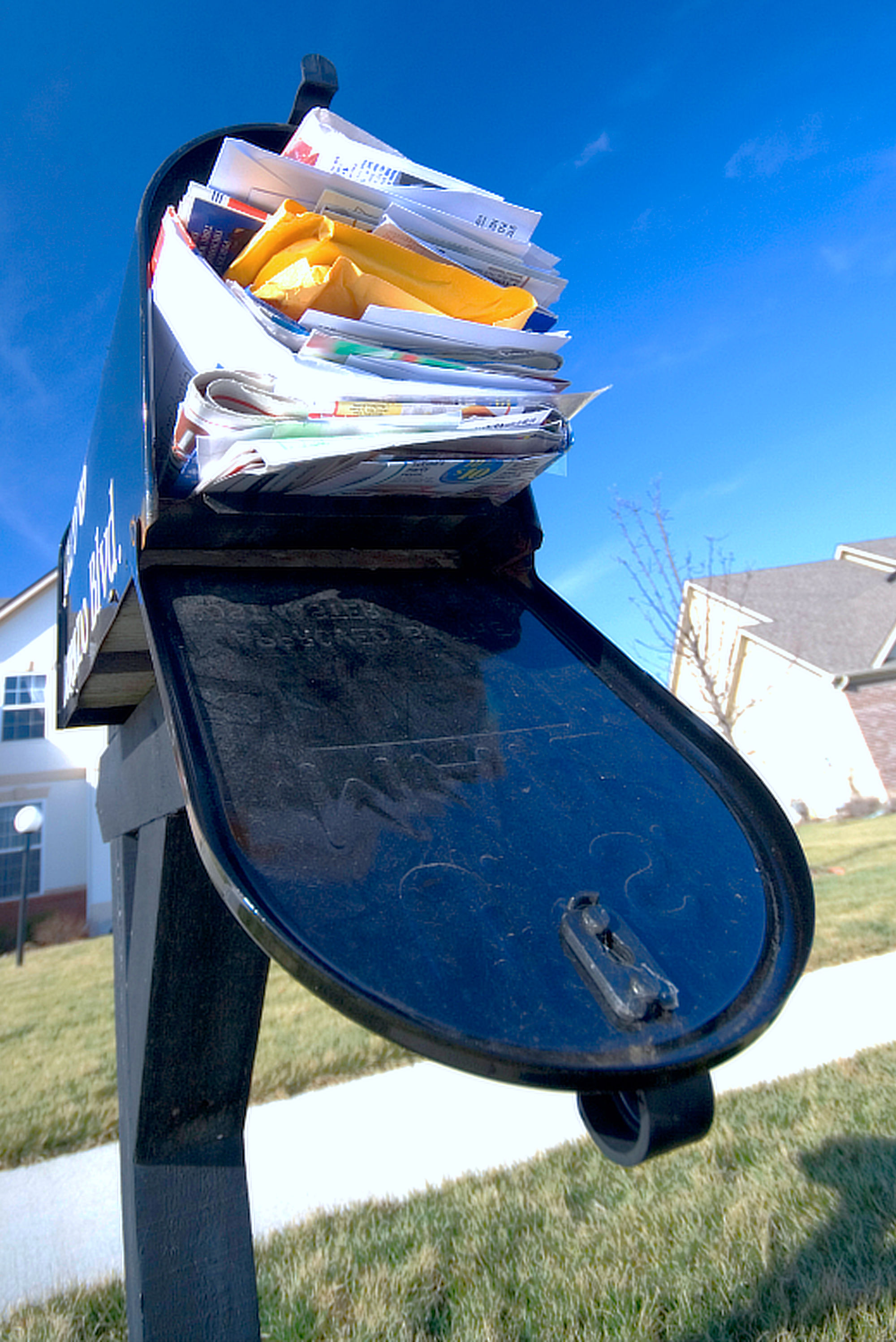 Mailbox filled with junk mail