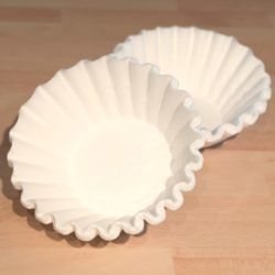 Some surprising uses for coffee filters. You can use and reuse coffee filters in lots of ways around the house, from lining planters to making dryer sheets. #snappyliving #repurposing #cleaning #homehacks