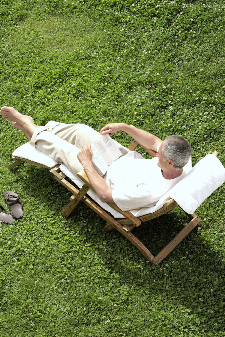 Man in lawn chair on expansive lawn