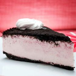 Piece of creamy white cake with Oreo crust