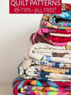 Stack of quilts of various patterns