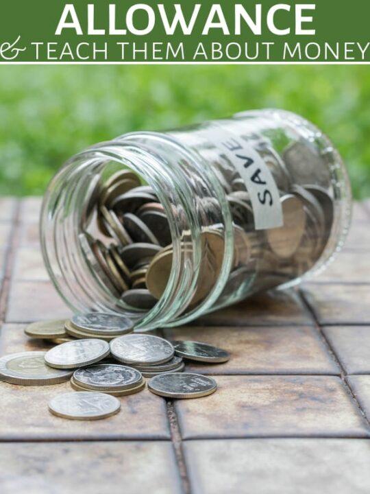 Kids allowance jar of coins spilling on table