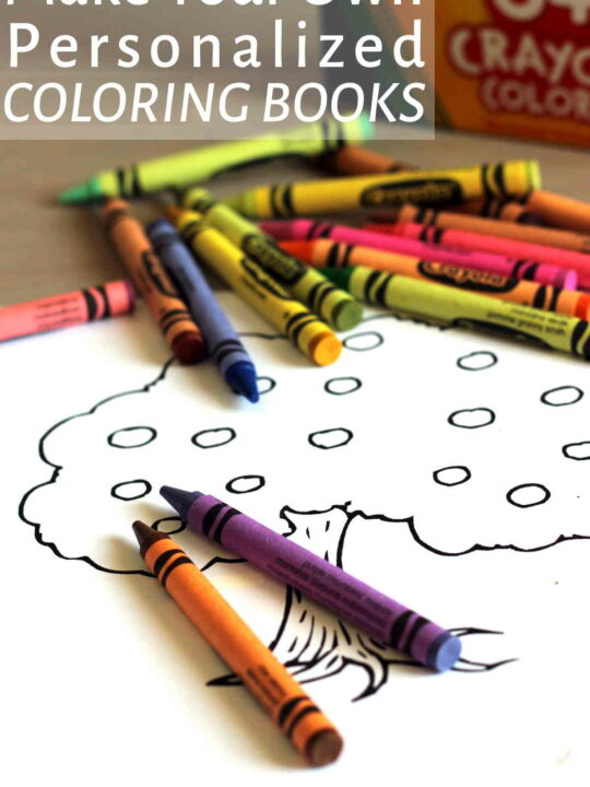 Coloring page on table with crayons