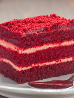Piece of red velvet cake on white plate