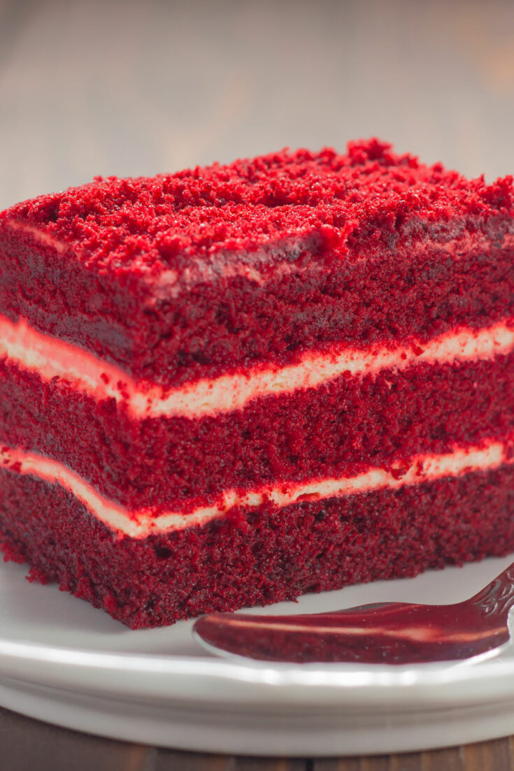This is the CLASSIC Red Velvet cake recipe. This traditional version lightly sweet and chocolatey, with a delicious buttercream icing. It's always a hit at parties!