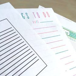Three different printable to do lists on a table