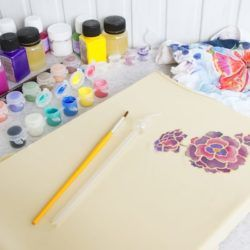 Fabric painting supplies and a painted fabric design