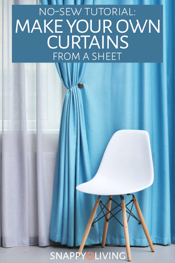 Blue sheet curtains hanging over white sheers