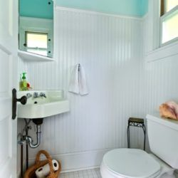 Small white and aqua bathroom