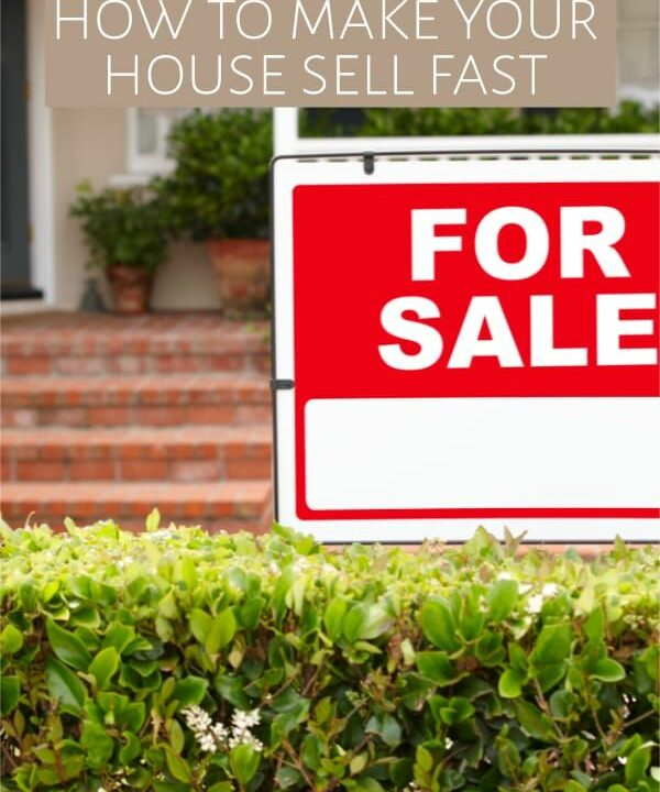Home with For Sale sign in yard