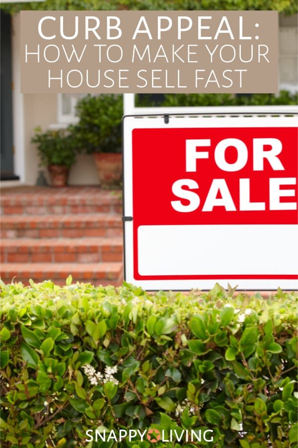 For sale sign in front of nice house with curb appeal