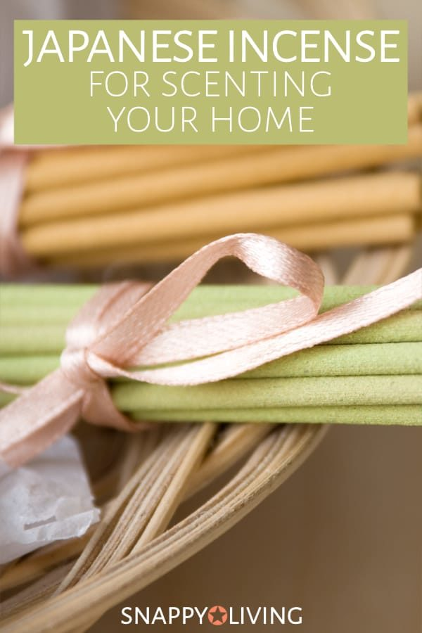 Two bundles of Japanese incense tied in ribbons
