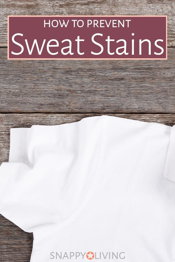 Clean white shirt with no sweat stains on wooden table