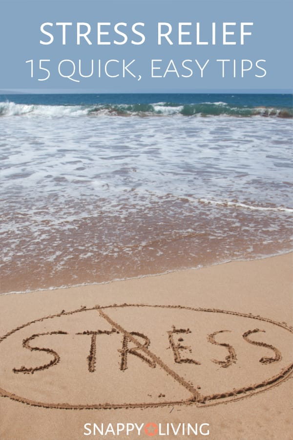 The word stress written in sand on a beach and crossed out
