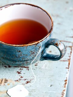 Cup of tea on blue table