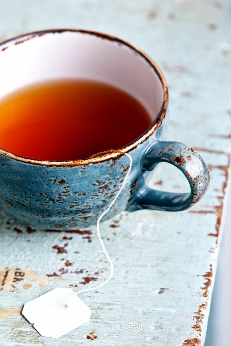 Cup of dessert tea on blue table