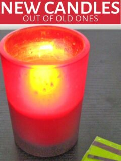 Candle burning in red holder
