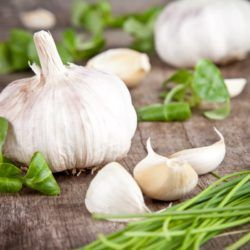 Garlic bulbs and cloves with chives