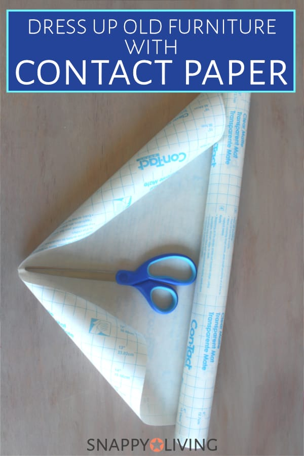 Contact paper roll with scissors