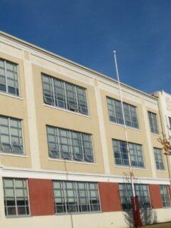 School building in front of beautiful blue sky