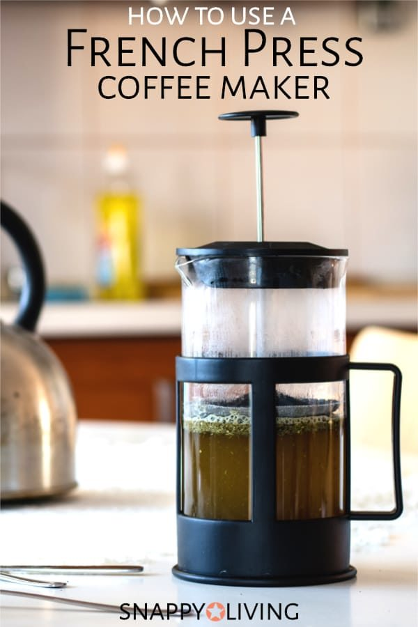 French press coffee maker with brewed coffee inside