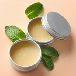 Lip balm in tins with mint leaves