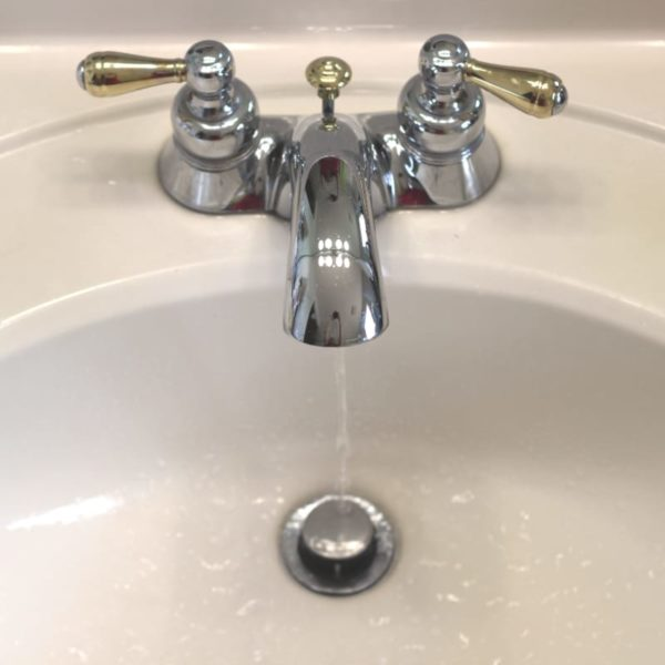Faucet running water into the sink